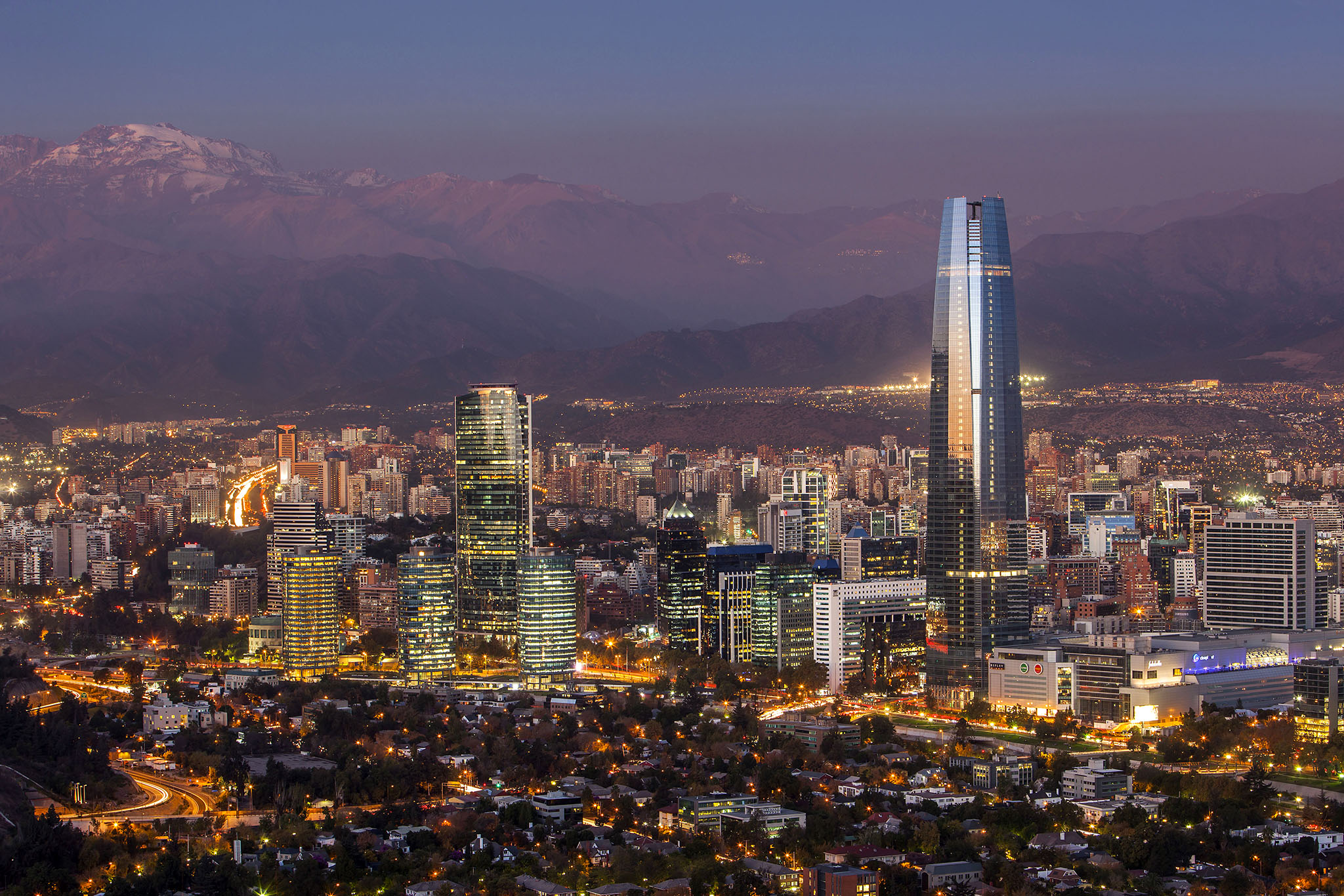 panorama of Santiago (Providencia buildings and the Gran Torre Santiago tower) and Andes Mountains, Santiago, Chile.